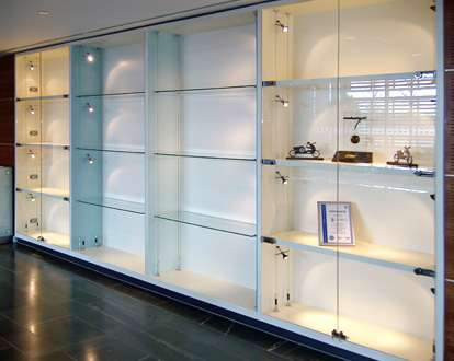 cabinet wall display with integral suspended shelving carrying lowvoltage lighting from tz lighting range