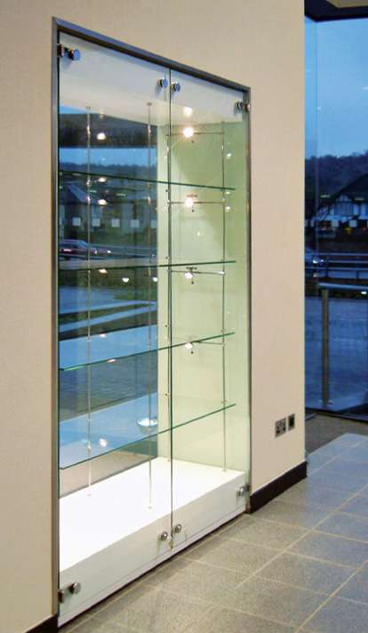 a built in display cabinet wall with suspended shelving and low voltage lighting for hospitality and & Glass Cabinet Display Walls | Shopkit UK