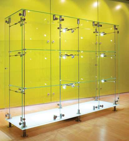 Freestanding Gl Display Cabinet With Satin Polished Stainless Steel Fixings And Featuring An Opaque White Base This Also Features Two